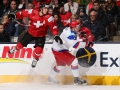 TORONTO, CANADA - DECEMBER 28: Switzerland's Kevin Fiala #10 gets out of the way from a hit by Russia's Dmitri Yudin #3 during preliminary round action at the 2015 IIHF World Junior Championship. (Photo by Andre Ringuette/HHOF-IIHF Images)